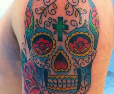 Skull and flowers tattoos