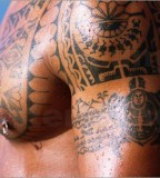 holger-leue-polynesian-tattoos-on-mans-chest-and-arms-66065