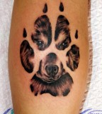 paw-and-wolf-image-in-paw-tattoo