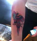 Parrot-arm-tattoo