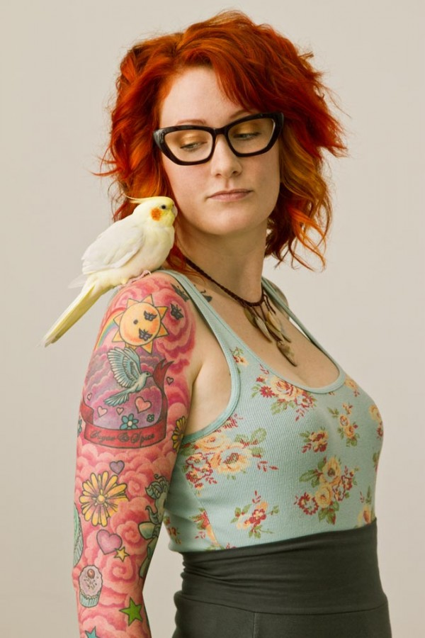 red hair girl tattoo girl with a bird