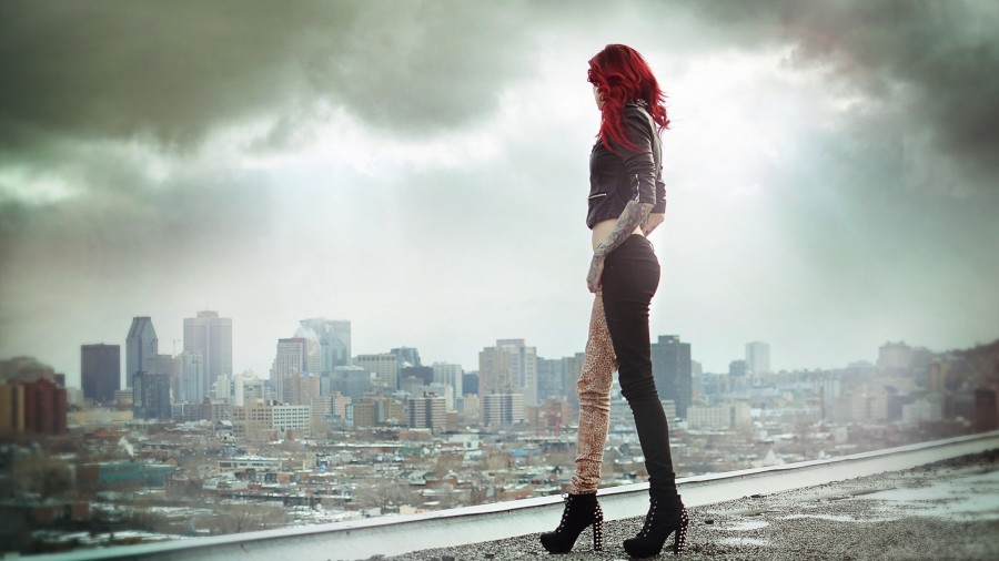 red hair girl tattoo looking at the city