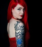 red hair girl tattoo skulls and blue roses