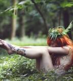 red hair girl tattoo wild nature