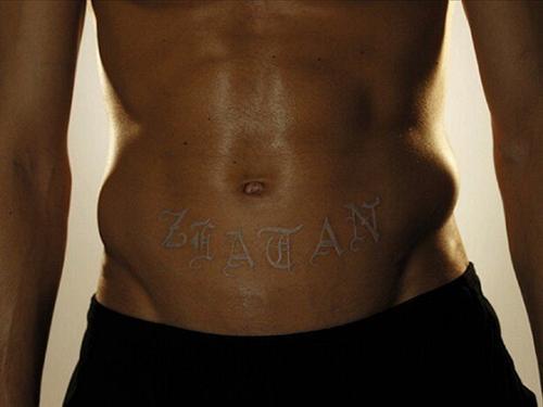 white ink tattoo on black skin