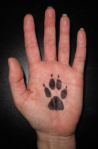 animal rights tattoo paw tatto on human hand