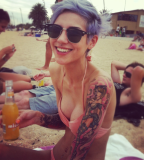 beach girl tattoo girl with piercing blue hair
