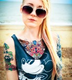 beach girl tattoo mickey mouse