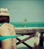 beach girl tattoo stars spine tattoo