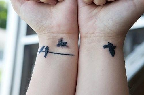elegant bird tattoo birds on wire