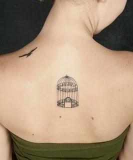 elegant bird tattoo bordcage on back