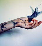 elegant bird tattoo graphic hand tattoo