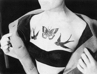 elegant bird tattoo on chest butterfly