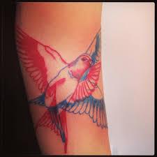 elegant bird tattoo red and blue tattoo motion