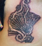 fan tattoo small back