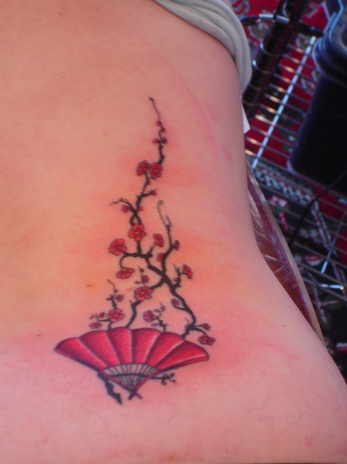 fan tattoo small red fan with blossoms