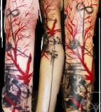geometric abstract tattoo red and black sleeve