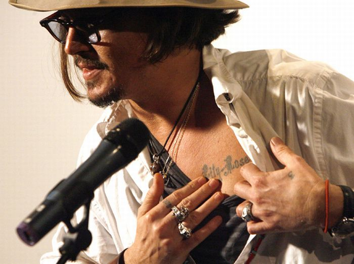 johnny depp tattoo lilly rose on chest