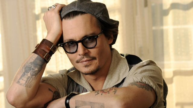 johnny depp tattoo portray on arm