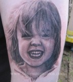 realistic tattoo smiling kid