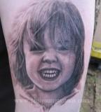 realistic tattoo smiling kid