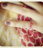 red ink tattoo tiny ribbon