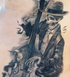 rockabilly tattoo playing skeleton