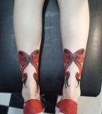 rockabilly tattoo red ribbons