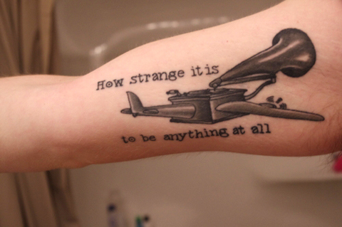 d83973330 song lyric tattoo how strange it is to be anything at all ...