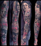 tattoo by Mike DeVries faces red blossoms sleeve