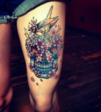thigh tattoo scull flowers
