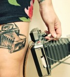 thigh tattoo vintage camera