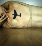 travel tattoo black plane