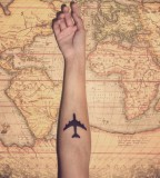 travel tattoo plane on arm