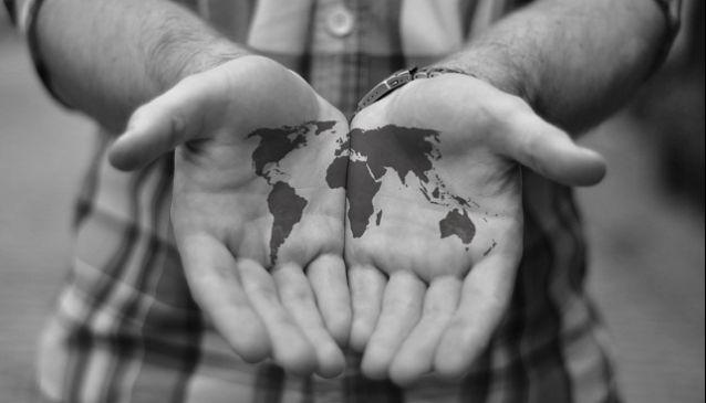 travel tattoo world in hands