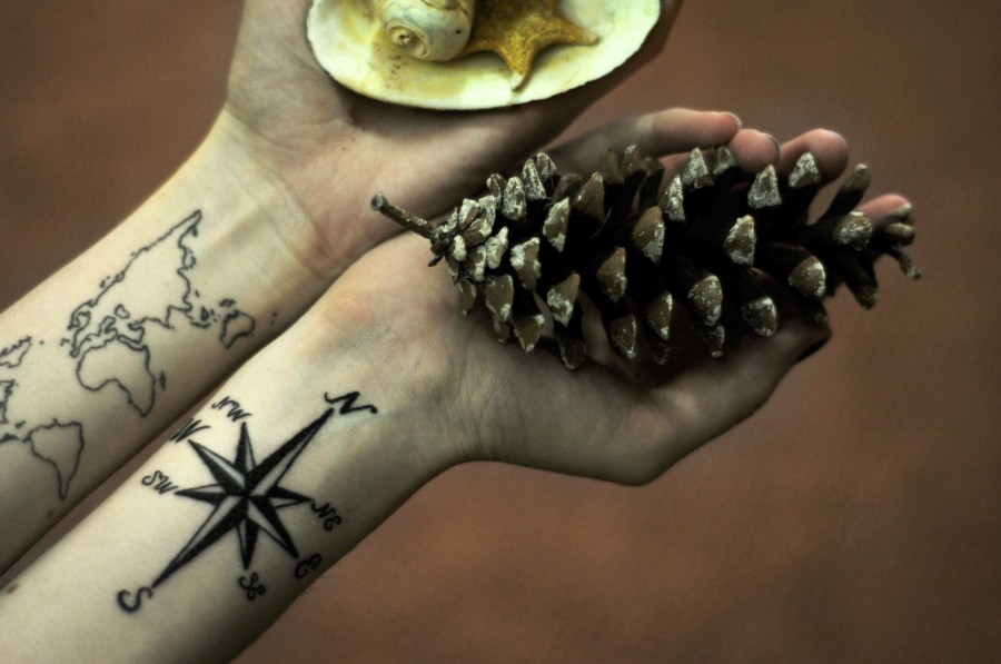 travel tattoo world map and compass pinecone