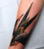 angry swallow tattoo by jimmy duvall