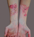 beautiful pastel pink blossoms tattoo