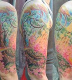 beautiful pastel tree tattoo sleeve