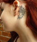 behind ear tattoo red haired girl