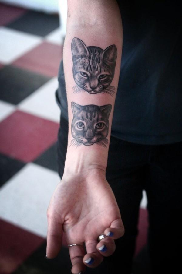 cat head on inside arm tattoo