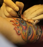 colorful tattoo in process