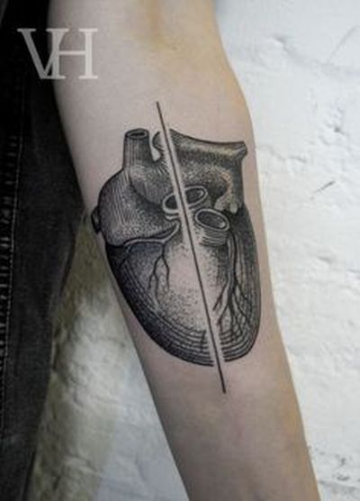 divided heart tattoo by valentin hirsch
