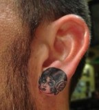 ear tattoo girl head