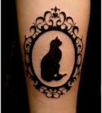 framed cat tattoo blackwork