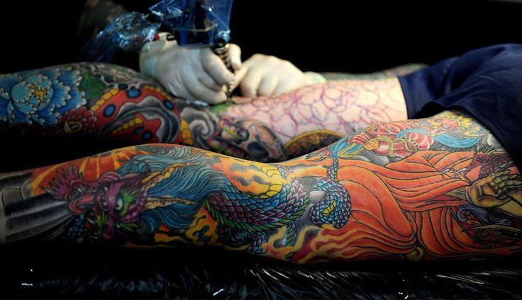 ful leg tattoo in process