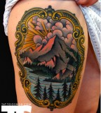 grand mountain tattoo on thigh