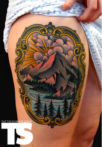 grand mountain tattoo on thigh