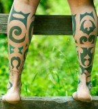 green tribal leg tattoos by idexa stern