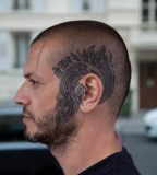 head tattoo around ear blue ink